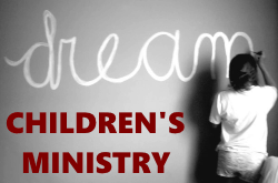 Logo of Dream Children's Ministry - Uganda: a child writing the word Dream large on a blackboard